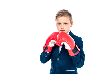 schoolboy in boxing gloves looking at camera Isolated On White with copy space Imagens