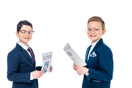 happy schoolboys pretending to be businessmen holding newspapers Isolated On White Stock Photo