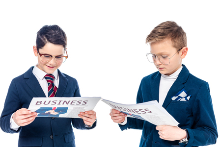 schoolboys in glasses pretending to be businessmen reading newspapers Isolated On White