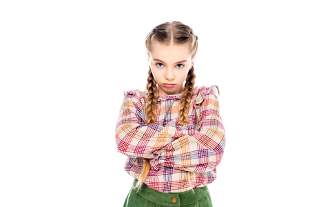 upset kid with crossed arms looking at camera Isolated On White 写真素材