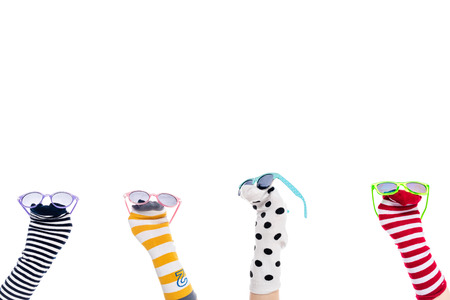 cropped view of people with colorful sock puppets and sunglasses on hands Isolated On White