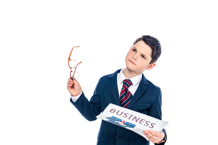 schoolboy in formal wear with glasses holding business newspaper Isolated On White Stock Photo