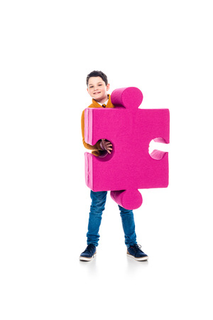 happy boy posing with jigsaw puzzle piece on white Stock Photo