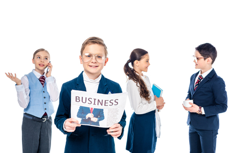 smiling schoolboy with newspaper near schoolchildren pretending to be businesspeople Isolated On White 版權商用圖片