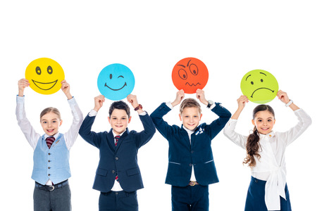happy schoolchildren in formal wear holding cards with various face expressions Isolated On White
