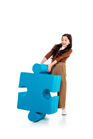 excited kid with jigsaw puzzle piece on white