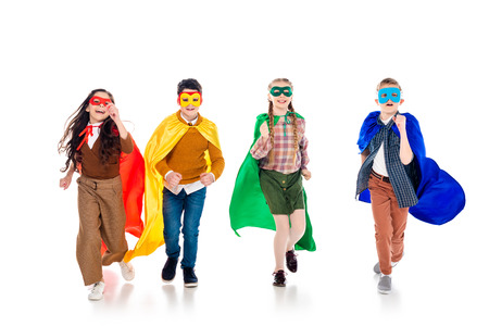 happy kids in superhero costumes and masks running On White