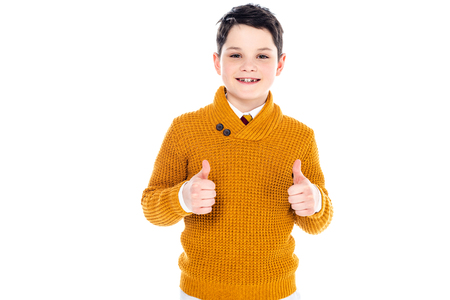 smiling boy in casual clothes showing thumbs up isolated on white 版權商用圖片 - 122814816