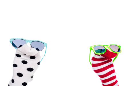 cropped view of person with colorful sock puppets and sunglasses on hands Isolated On White Banque d'images - 122815092