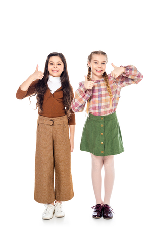 happy kids looking at camera and showing thumbs up signs On White Stock Photo