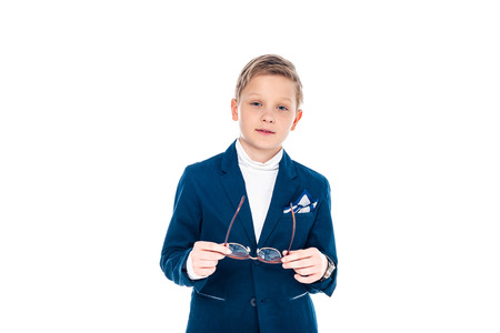 schoolboy in businessman suit holding glasses and looking at camera Isolated On White Stockfoto