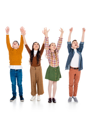 cheerful schoolchildren with outstretched hands On White