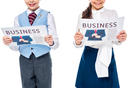 cropped view of schoolgirls in formal wear with business newspapers Isolated On White