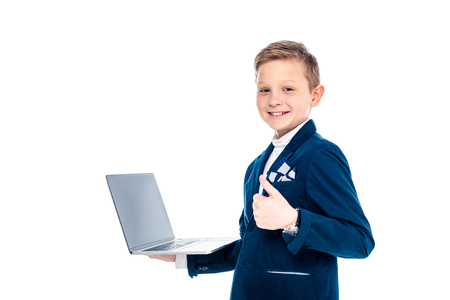 happy schoolboy in businessman suit with laptop showing thumb up Isolated On White