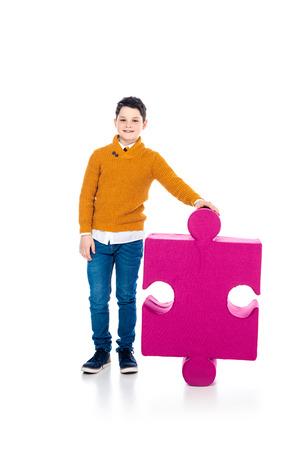 happy boy posing with jigsaw puzzle piece on white 版權商用圖片 - 122815249