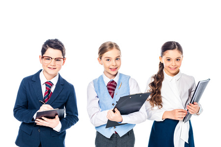smiling schoolchildren with clipboards pretending to be businesspeople Isolated On White