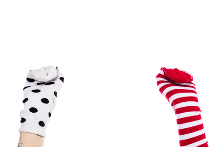 partial view of person with colorful sock puppets on hands Isolated On White with copy space Banque d'images - 122815260