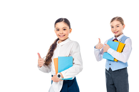 happy schoolgirls in formal wear with books showing thumbs up Isolated On White
