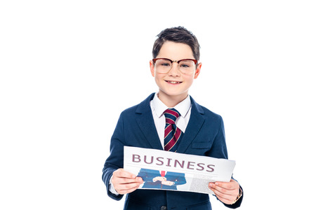 happy schoolboy in formal wear and glasses with business newspaper Isolated On White 版權商用圖片 - 122815323