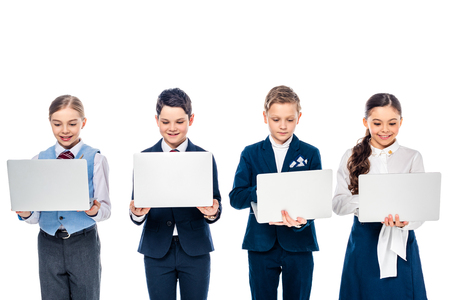 schoolchildren pretending to be businesspeople using laptops Isolated On White
