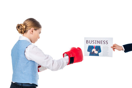 schoolgirl in boxing gloves and hand of schoolboy with business newspaper Isolated On White Stok Fotoğraf