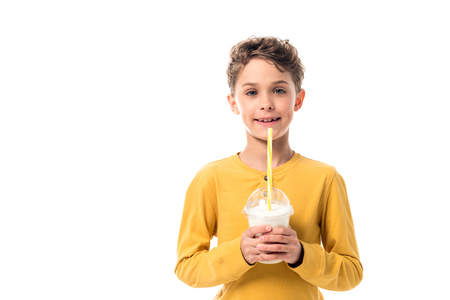 front view of happy kid holding milkshake isolated on white
