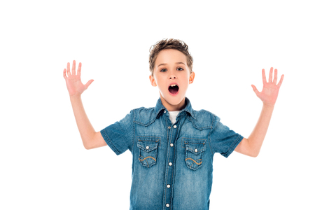 front view of surprised kid in denim shirt waving hands isolated on white Фото со стока