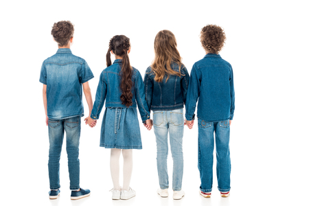 back view of four kids holding hands isolated on white 写真素材