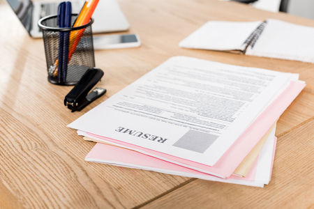 Selective focus of resume near stapler and pen holder on table