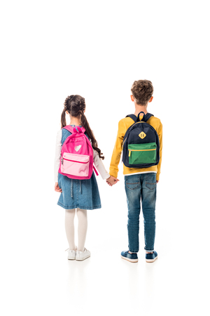 back view of schoolchildren with backpacks holding hands isolated on white 版權商用圖片