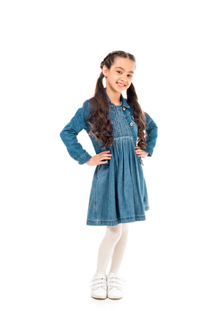 Full length view of smiling kid in denim dress isolated on white background Stockfoto