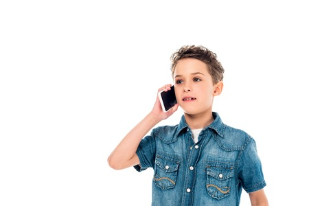 child in denim shirt talking on smartphone isolated on white