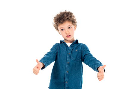 emotional kid in denim shirt showing thumbs up isolated on white