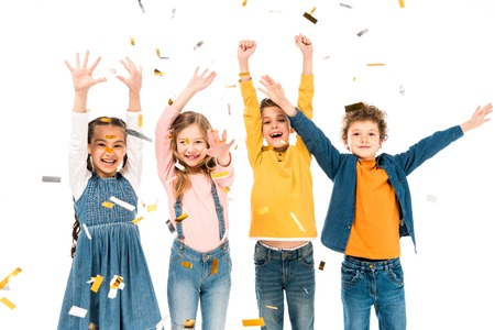 Four happy kids waving hands under confetti isolated on white background