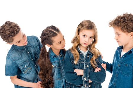 children in denim clothes encouraging sad friend isolated on white