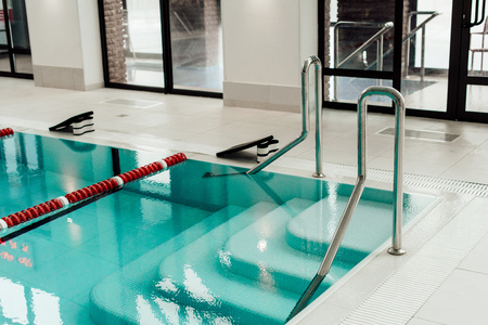 modern swimming pool with lane dividers, pull buoys and swimming kickboards