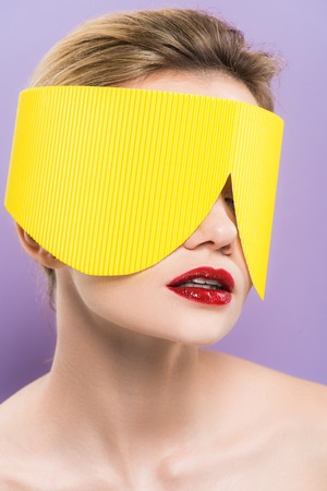 young woman with red lips in yellow paper glasses isolated on purple Stock fotó