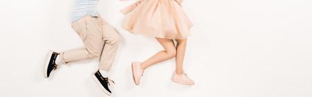 panoramic shot of kid near friend in pink dress on white Standard-Bild - 122866093