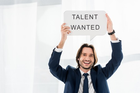 cheerful recruiter holding speech bubble with talent wanted lettering Stockfoto - 122867487