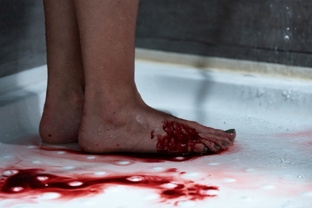 partial view of barefoot bleeding woman in bathroom Stock fotó