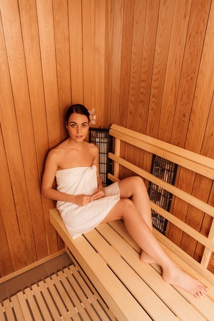 high angle view of woman in towel in sauna