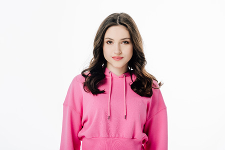 attractive confident girl in pink hoodie looking at camera isolated on white