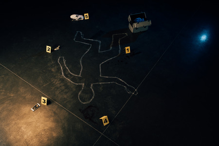 chalk outline, smartphone, dollar banknote, shoe, investigation kit and evidence markers at crime scene