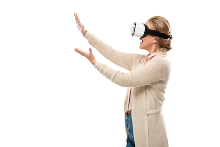 Woman in vr headset experiencing Virtual reality and gesturing isolated on white with copy space