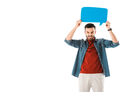 Irritated man holding speech bubble above head and looking at camera isolated on white background