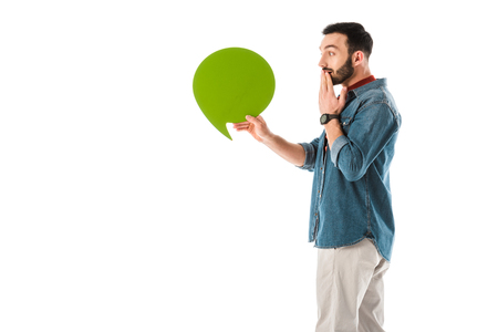 Surprised man with thought bubble covering mouth with hand isolated on white background