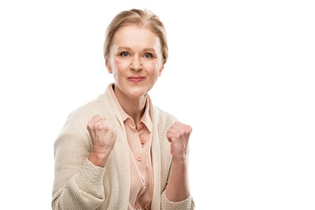 dissatisfied middle aged woman with clenched fists Isolated On White Stock Photo