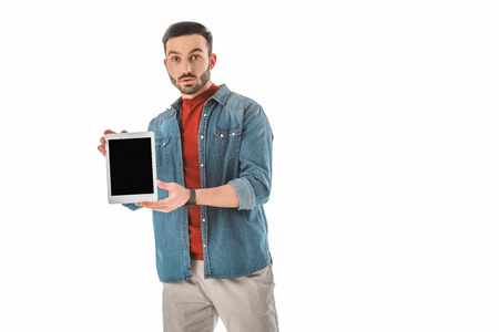 Surprised man looking at camera while holding digital tablet with blank screen isolated on white background