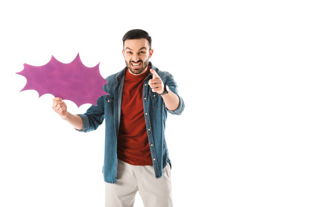 Irritated man with thought bubble looking at camera and pointing with finger isolated on white background