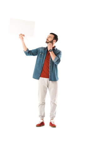 Thoughtful man in denim shirt holding speech bubble isolated on white background